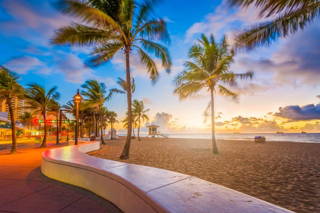 The sun sets on the beach of Fort Lauderdale, one of the best day trips from Miami.