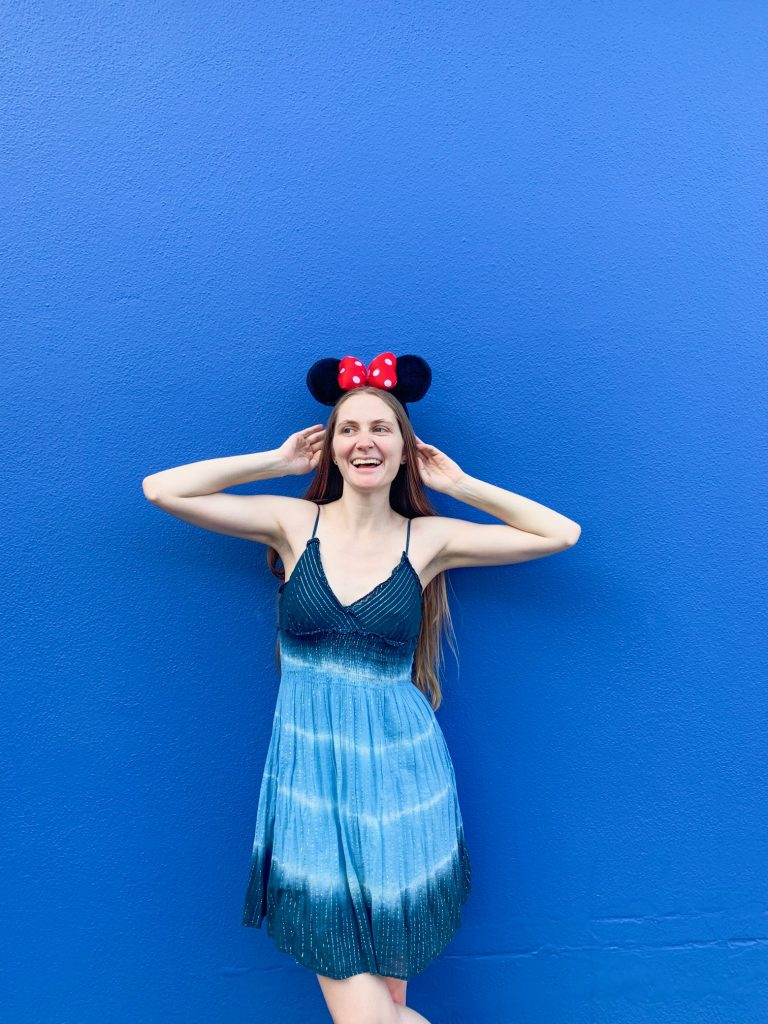 Head to Disney World to spot one of the Insta-worthy walls where a girl is posing on a blue wall with mickey ears