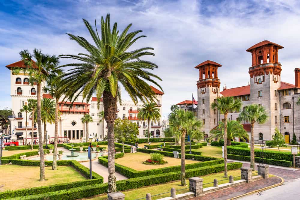 Flager college in Saint Augustine with manicured gardens, fountain in middle and large palm trees