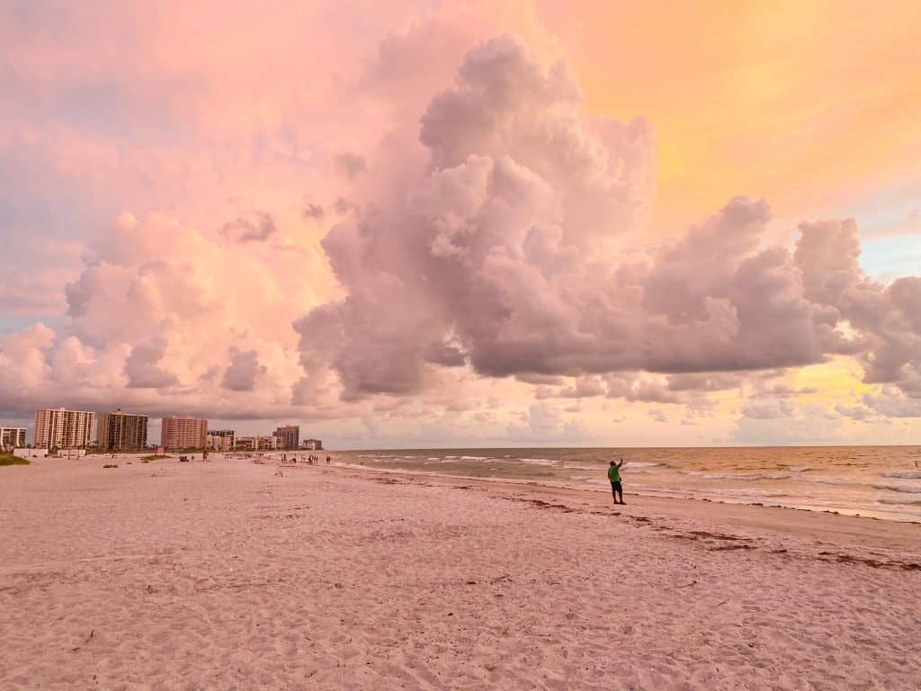 a beautiful sunset with Clearwater beach in the background