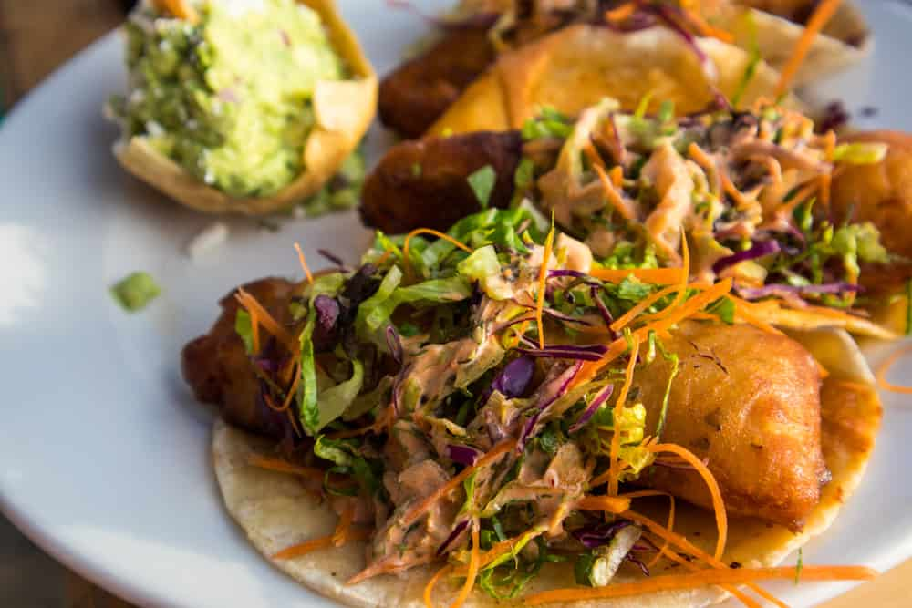 Tacos with fried fish and slaw on a plate