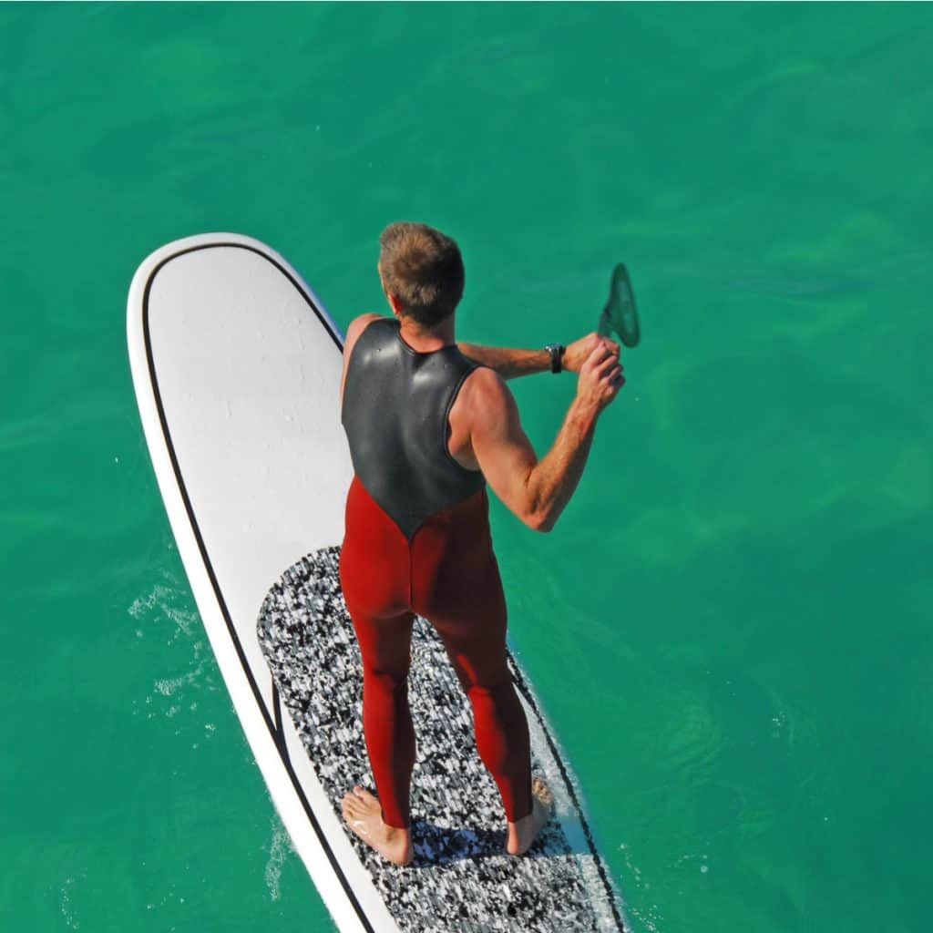 MAN STANDUP PADDLE BOARDING AT QUIETWATER BEACH IN PENSACOLA