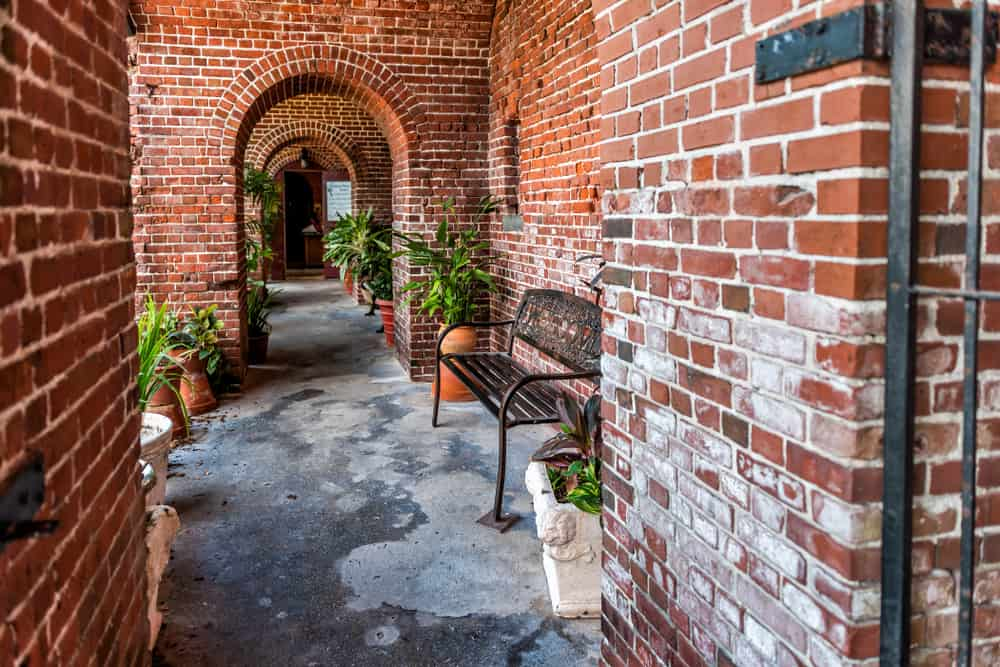 A brick path in Key West Garden Club at Martello Tower, one of the most unique botanical gardens in Florida.