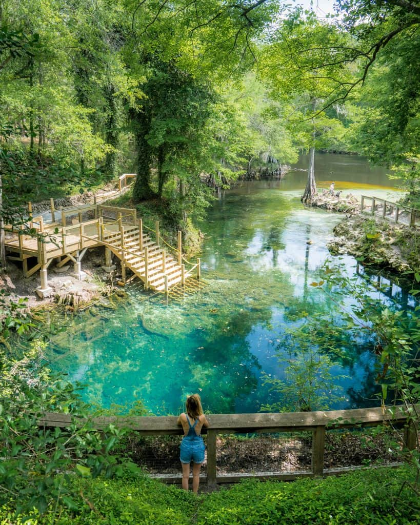 Girl beside stairs overlooking natural crystal clear springs near Tallahassee, florida