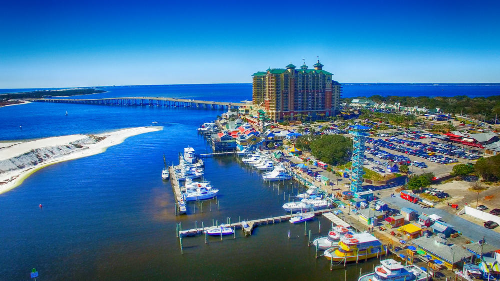 Destin from an arial view with the water, bridge and harbor with the boardwalk restaurants