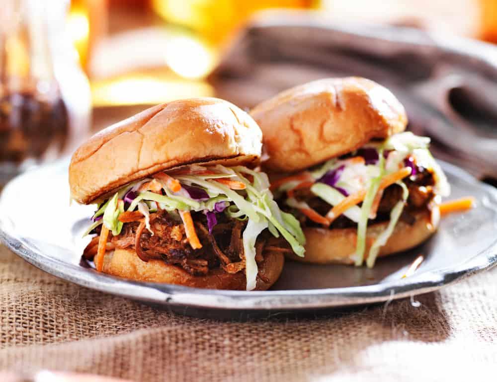two bbq pork sandwiches with slaw