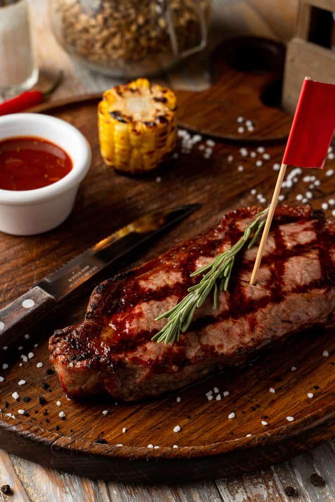 Vinny McGuires serves up a steak with roasted corn