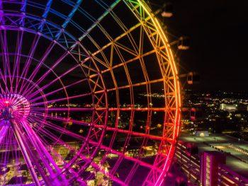orlando eye at night lit up in rainbow lights