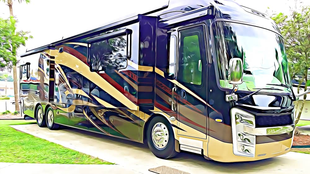 A black and gold class A motorhome on a concrete slab at an RV park