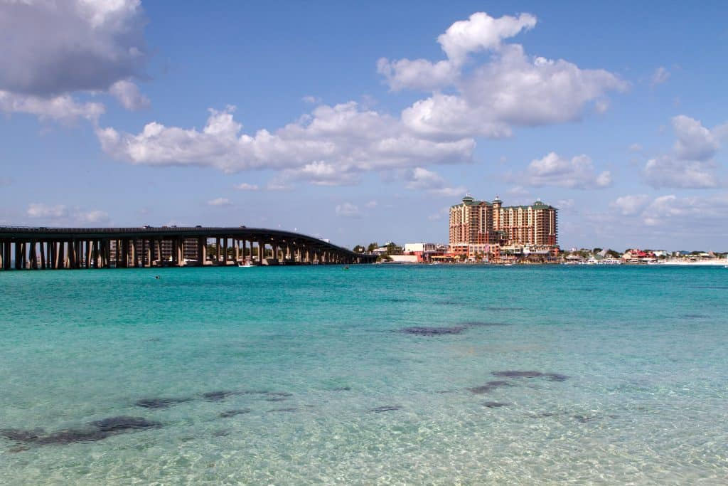 The clear blue-green waters of Crab Island, Florida glitter in the sunlight.