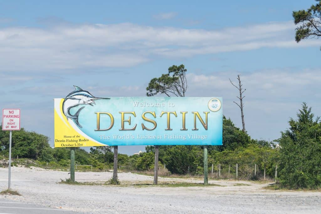 A sign welcomes guests to Destin, where you can find Crab Island