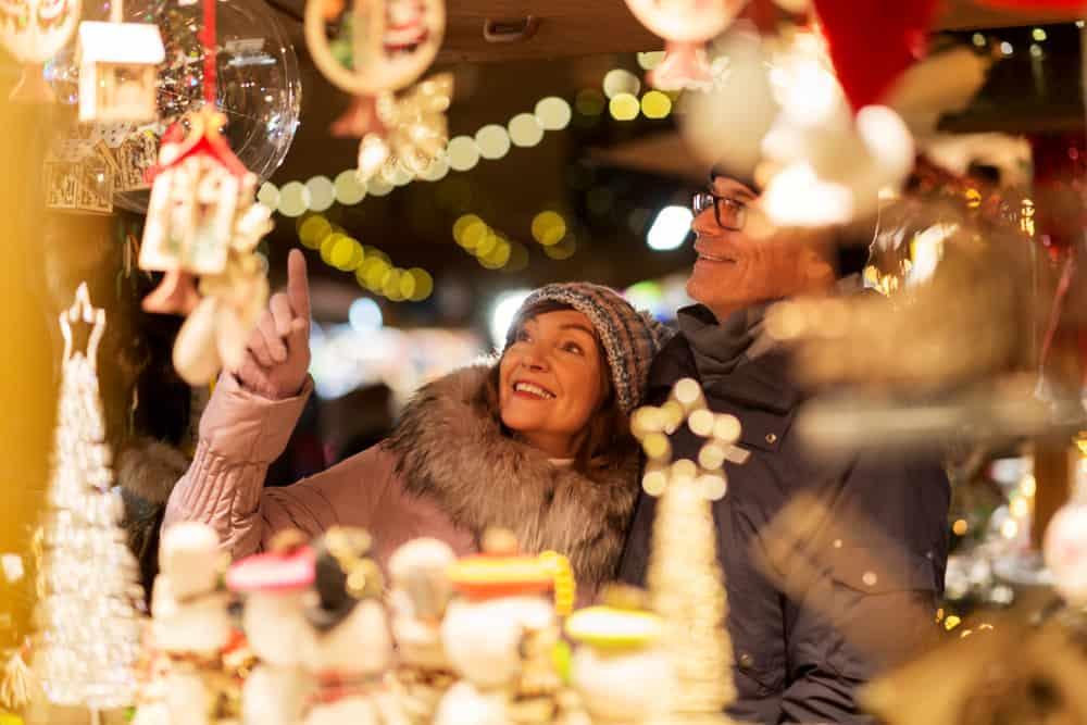 Two people at a Christmas market stall in an article about Christmas in Miami