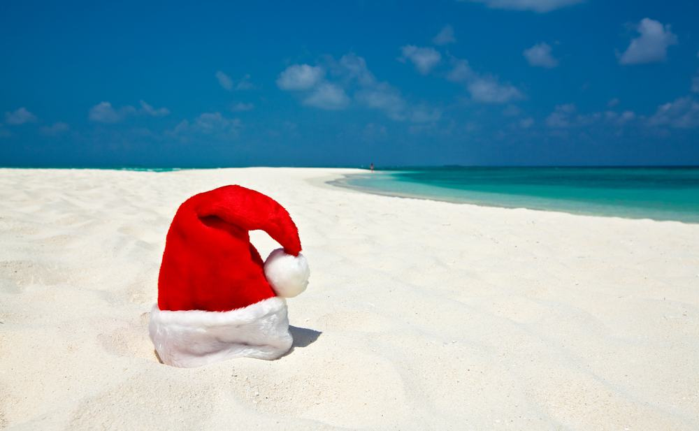 Santa Hat on the beach in an article about Christmas in Miami.