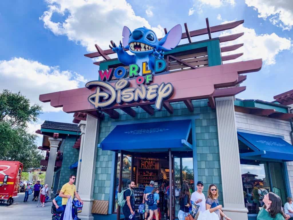 The World of Disney storefront with Stitch overlooking guests at disney springs mall in orlando