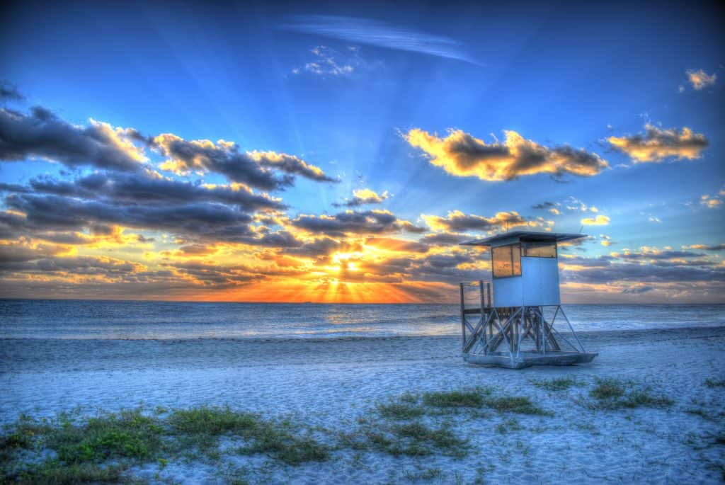 The sun rises over Jupiter Beach and one of its lifeguard stations.