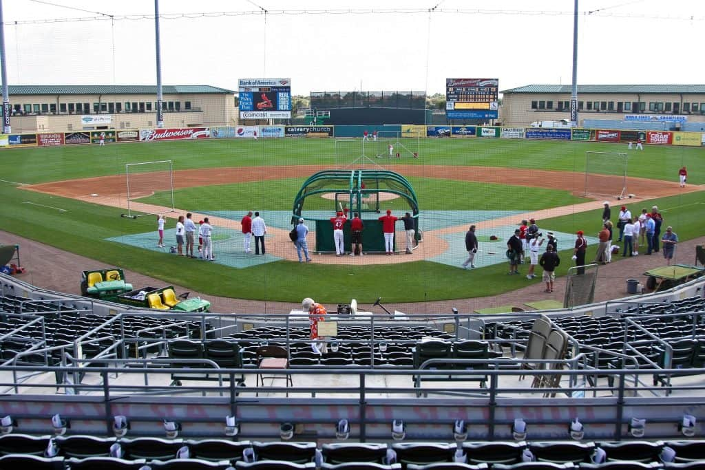 Players scrimmage behind home plate at Roger Dean Stadium