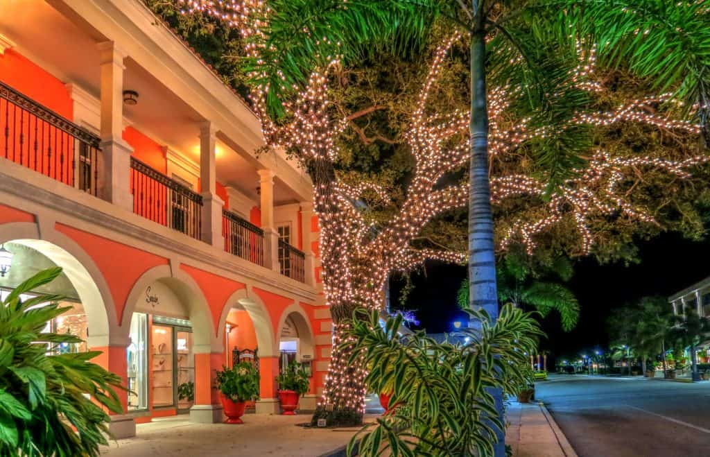 A historic building with a light-decked tree in one of the florida christmas towns