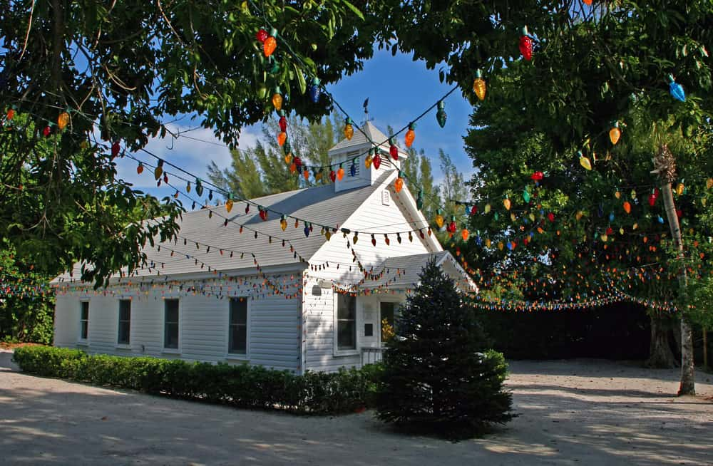 This white chapel is small and decorated with colorful lights.