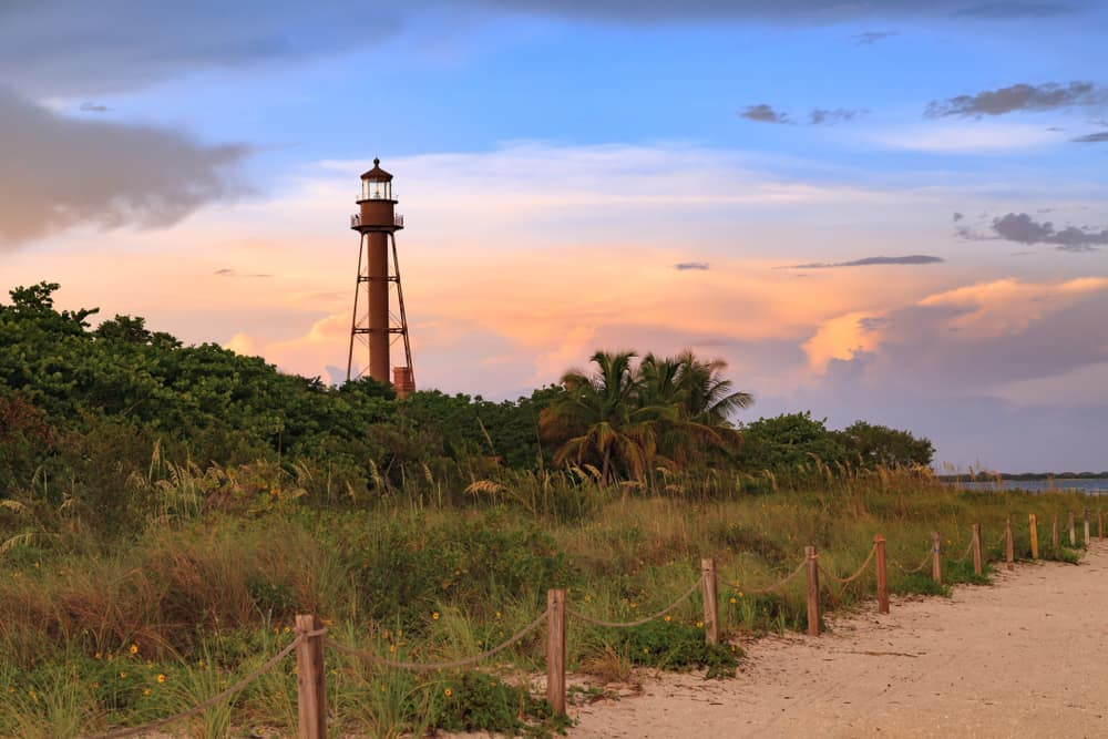 The Sanibel Lighthouse sets a strong contrast to a sunset.