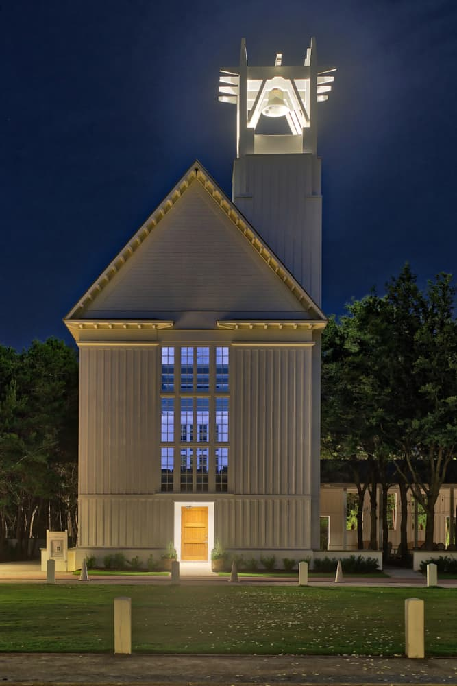 The Chapel at Seaside with its bell-tower illuminated at night, one of the best things to do in Seaside, Florida.