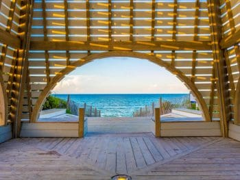 The interior of a wooden beach pavilion in Seaside, Florida looking out onto the ocean