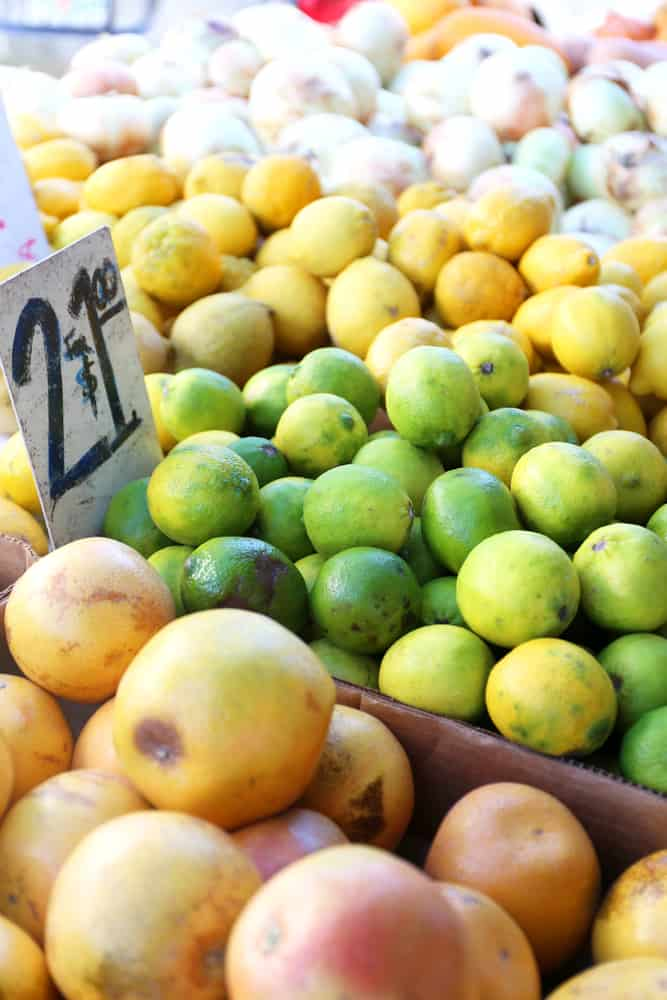 Lemons and limes for sale at an outdoor farmer's market in Florida.