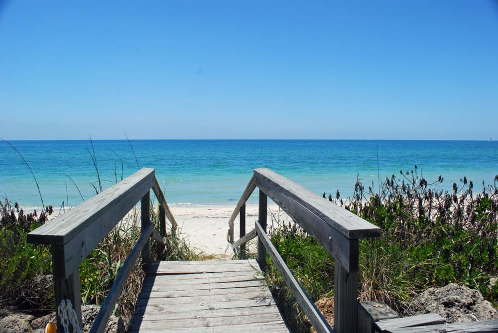 Walkway leading to Casey Key Beach with the gulf in the background.
