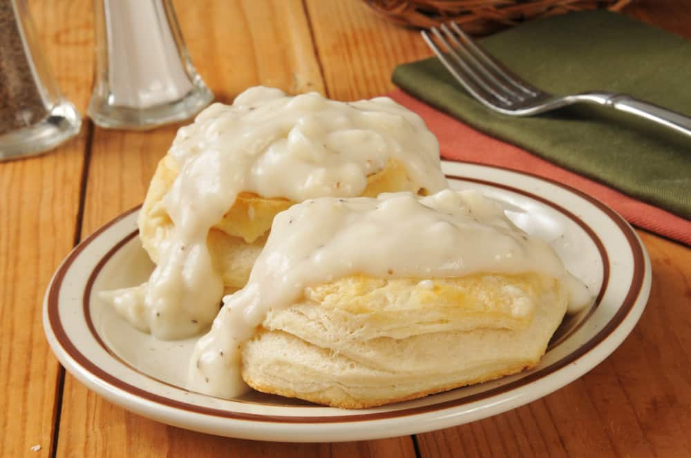 biscuits and grace on a plate for the best breakfast in Anna Maria Island