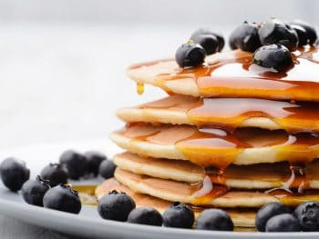 pancakes with blueberries on them for breakfast in anna maria island
