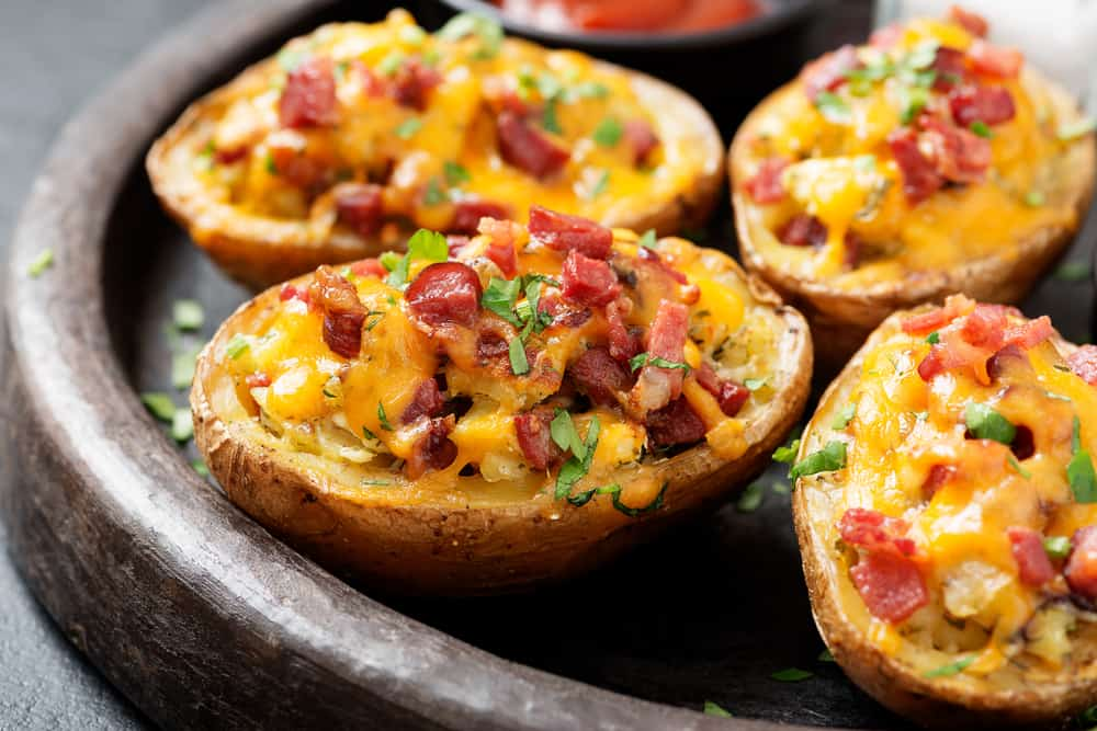 a wooden plate with several loaded potato skins at one of the best restaurants on anna maria
