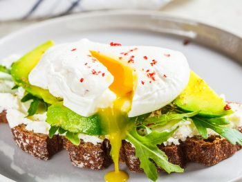 Avocado toast with poached egg and cheese, similar to what you can get for breakfast in Naples, FL.