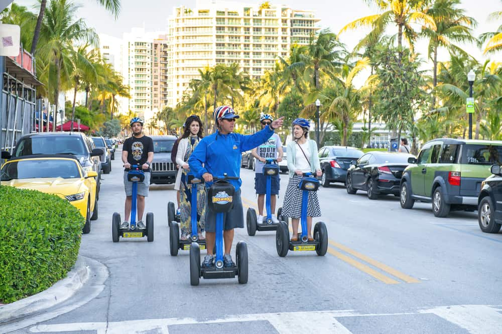 people riding segways on the street in Miami on one of the best tours in Miami