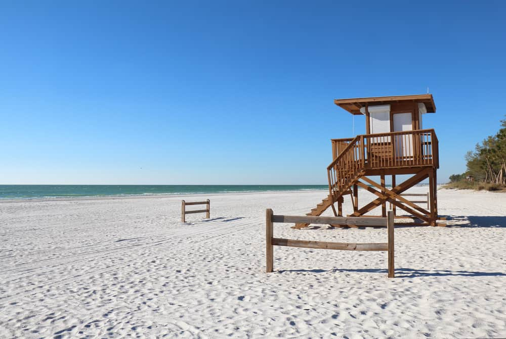 A nice lifeguard hut on a white sand beach, which is one of the best things to do in Anna Maria Island. The beach is empty and there are no waves in the ocean.